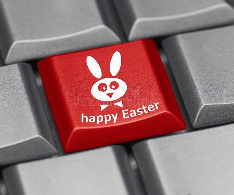 Tasto del computer - Pasqua felice con coniglio fotografie stock libere da diritti