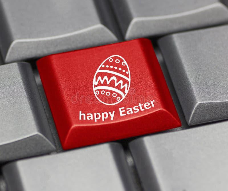 Tasto del computer - Pasqua felice con l'uovo fotografia stock
