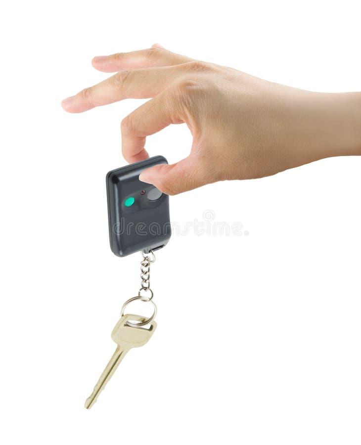 Tasto dell'automobile della holding della mano fotografia stock libera da diritti
