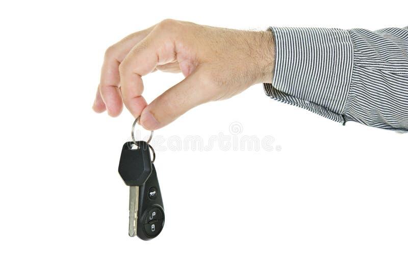 Tasto dell'automobile della holding della mano immagini stock libere da diritti