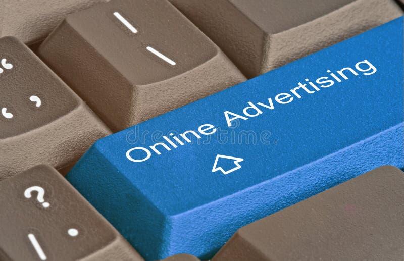 tasto per la pubblicità on line fotografie stock