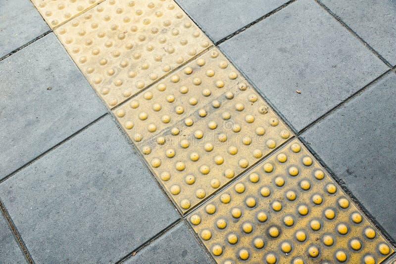 Tastpflasterung für blindes Handikap lizenzfreie stockbilder