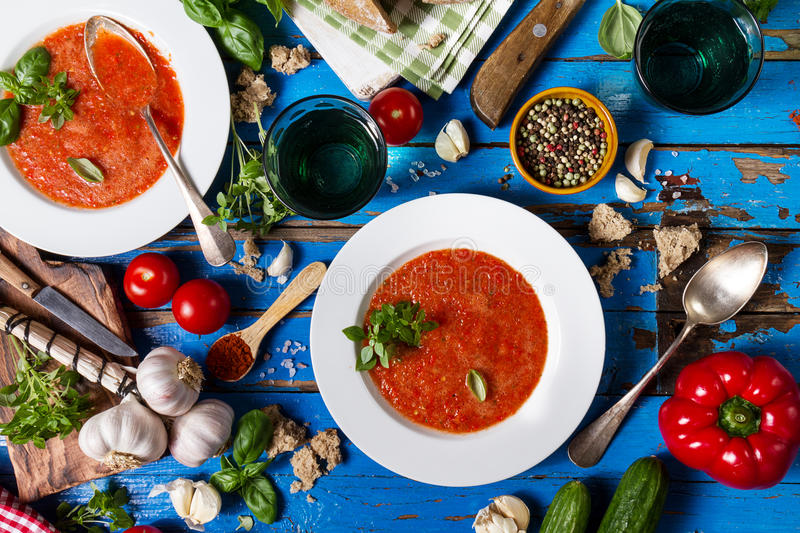 Tasty appetizing classic spanish soup gazpacho in white plates o stock images