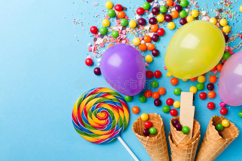 Tasty appetizing Party Accessories on Bright Blue Background royalty free stock photos