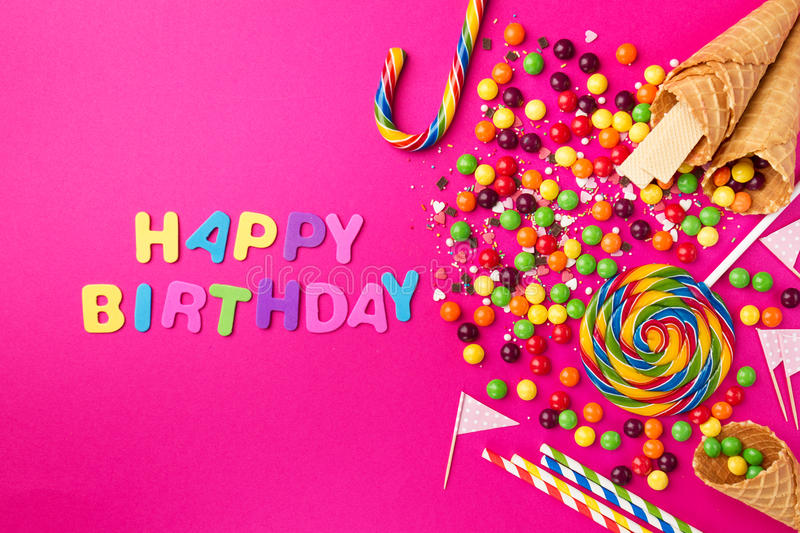 Tasty appetizing Party Accessories Happy Birthday on Bright Pink stock image
