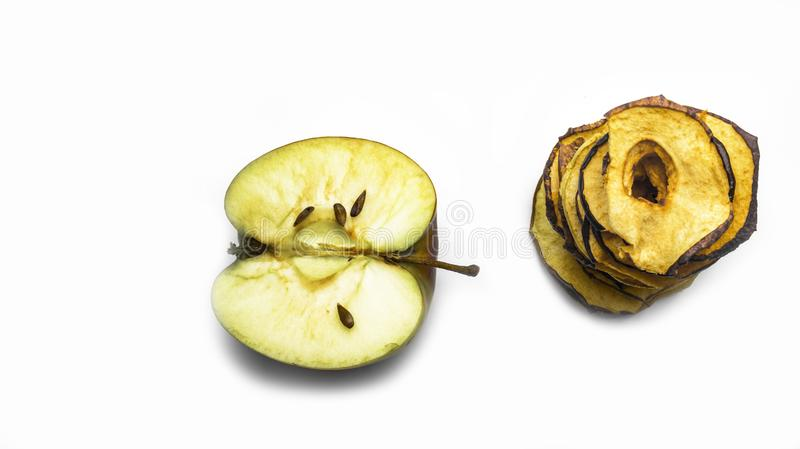 Tasty apple chips isolated on white, healthy vegan vegetarian fruit snack or ingredient for cooking, banner, panarama. Copy space stock photography