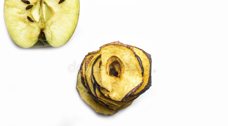 Tasty apple chips isolated on white, healthy vegan vegetarian fruit snack or ingredient for cooking, banner, panarama. Copy space stock photo