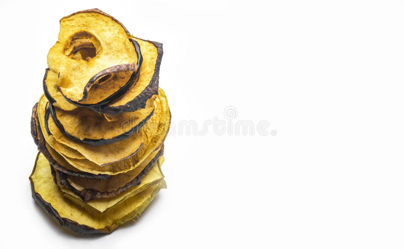 Tasty apple chips isolated on white, healthy vegan vegetarian fruit snack or ingredient for cooking. Copy space royalty free stock photography