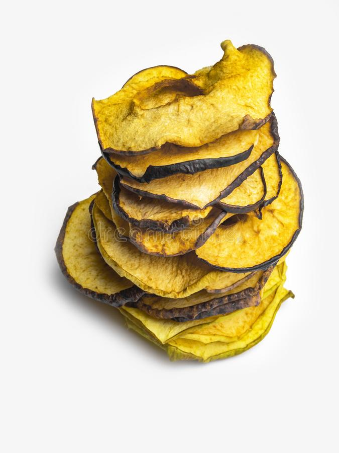 Tasty apple chips isolated on white, healthy vegan vegetarian fruit snack or ingredient for cooking. Copy space stock image