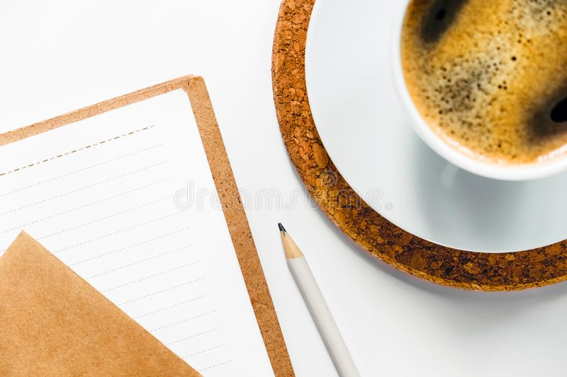 Tasty aroma coffee on white desk with paper. royalty free stock images