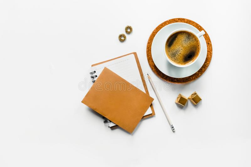 Tasty aroma coffee on white desk with paper. royalty free stock photography