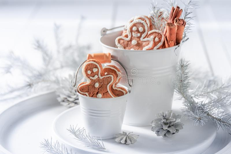 Tasty and aromatic gingerbread man for Christmas. On white table stock photo
