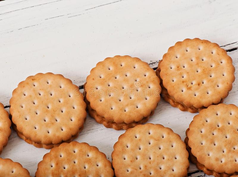 Tasty baked cookies. Tasty baked cookies on old wooden background royalty free stock photo