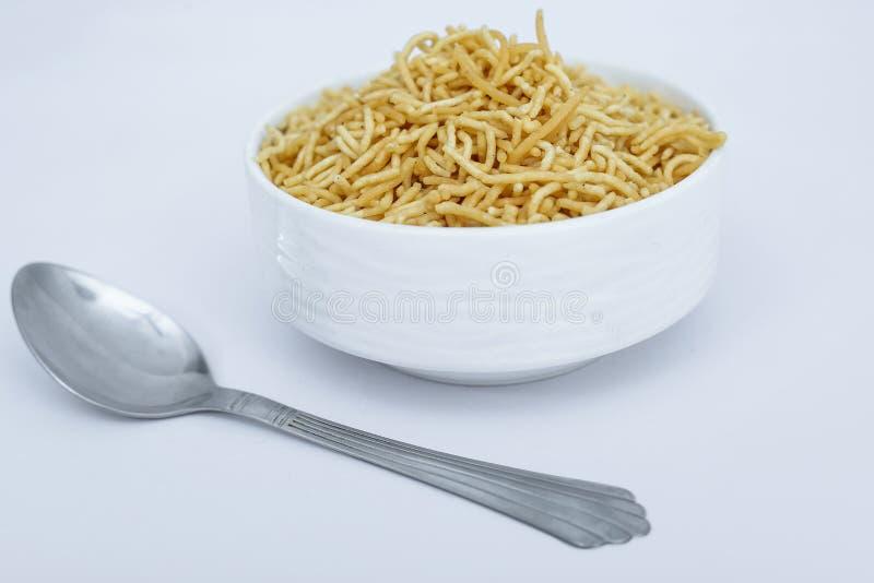 Tasty bikaneri namkeen bhujia in the bowl with spoon stock image