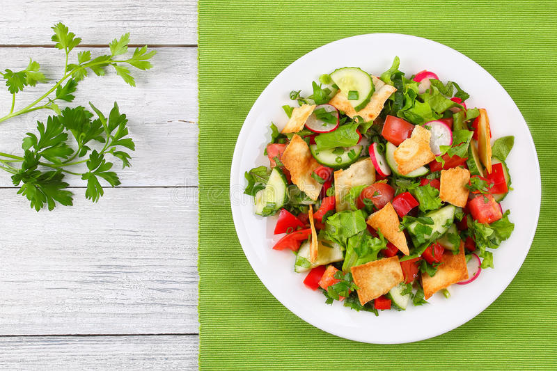 Delicious Fattoush Or Bread Salad With Pita Croutons Fresh Vegetables And Herbs On White Plate Wooden Table Easy Healthy Authentic Recipe