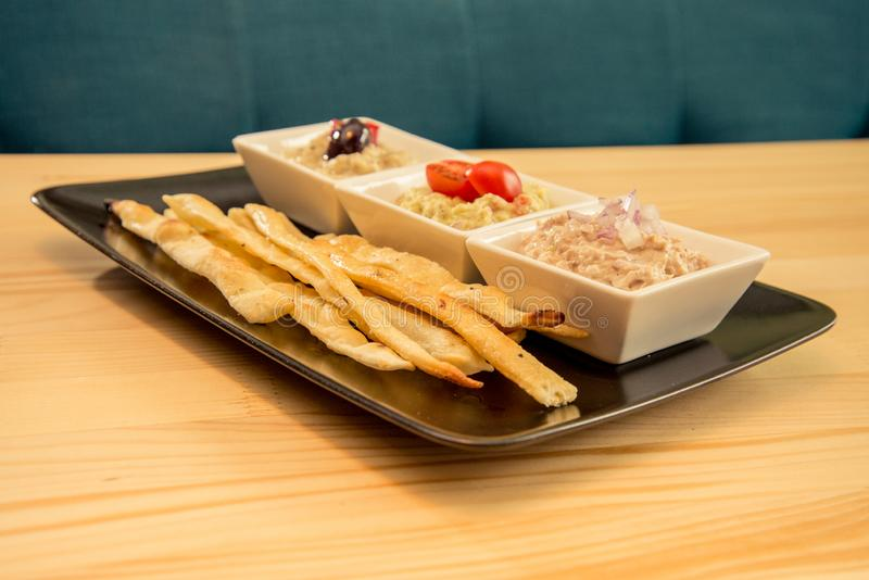 Tasty bread sticks with bunch of dips stock photo