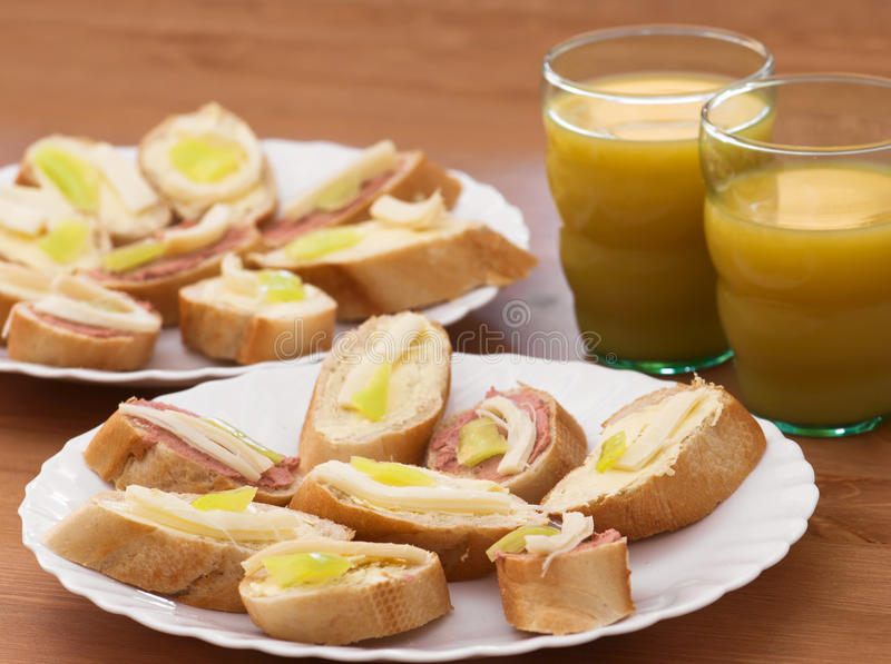 Tasty canapes with juice stock photo