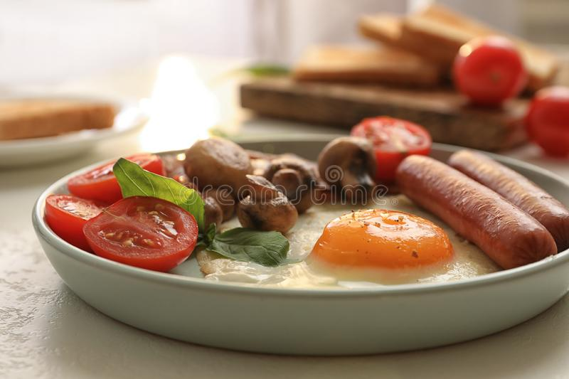 Tasty breakfast with fried egg on table. Closeup royalty free stock photo