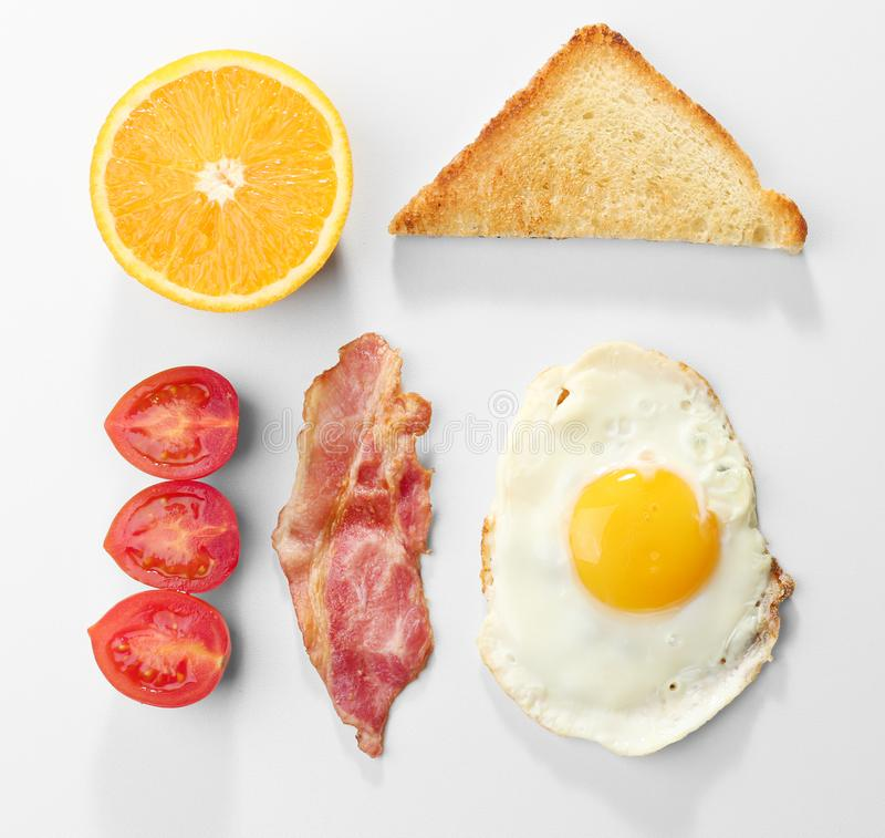 Tasty breakfast with fried egg. On white background stock photo
