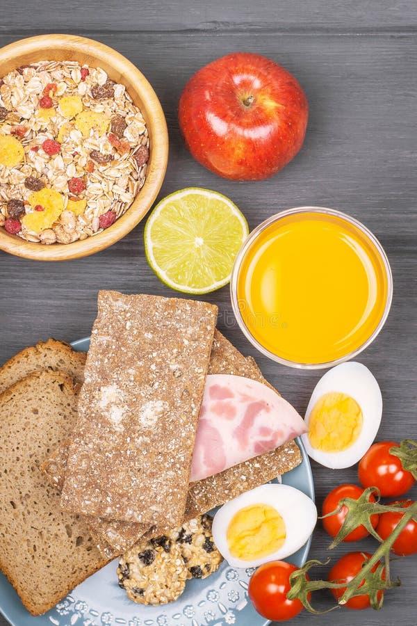 Tasty breakfast with juice, muesli, apple and bread royalty free stock photos