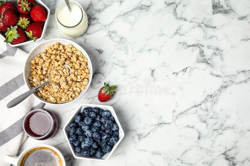 Tasty breakfast served on white marble table. Space for text. Tasty breakfast served on white marble table, flat lay. Space for text royalty free stock images