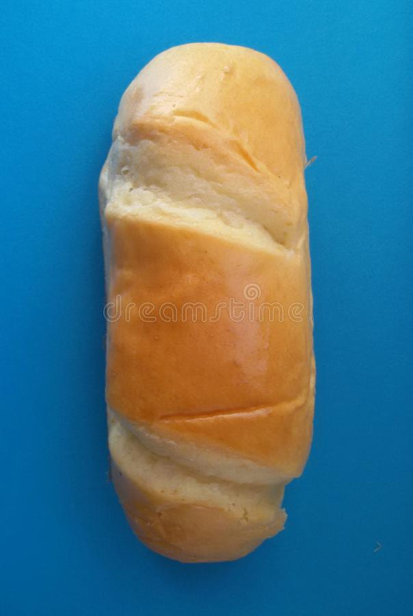 Delicious French roll bread. Soft and sweet bun over blue background. Tasty bun over blue. Fresh homemade French roll bread stock photo