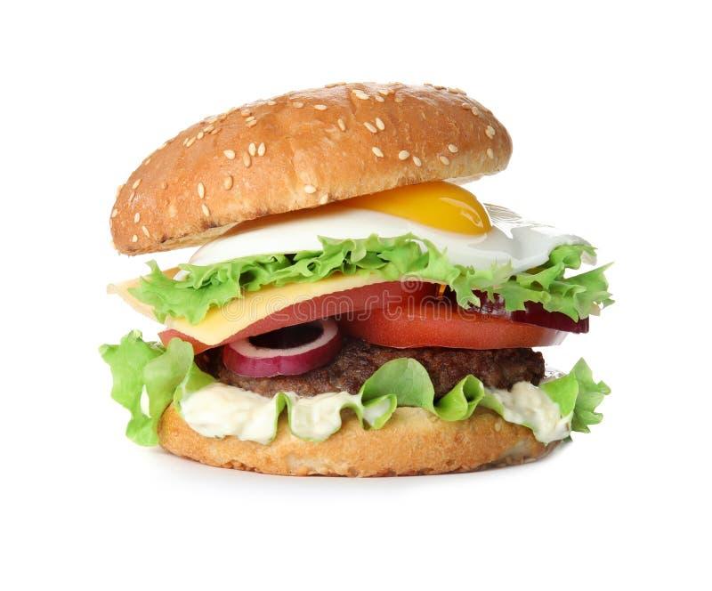 Tasty burger with fried egg. On white background stock photos