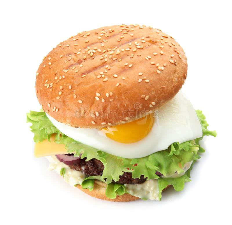 Tasty burger with fried egg. On white background royalty free stock photos