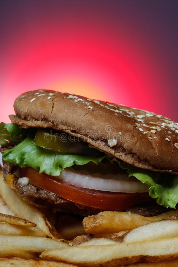 Tasty Burger. With red background royalty free stock photography