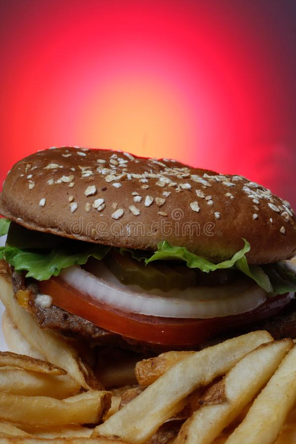 Tasty Burger. With red background royalty free stock photo