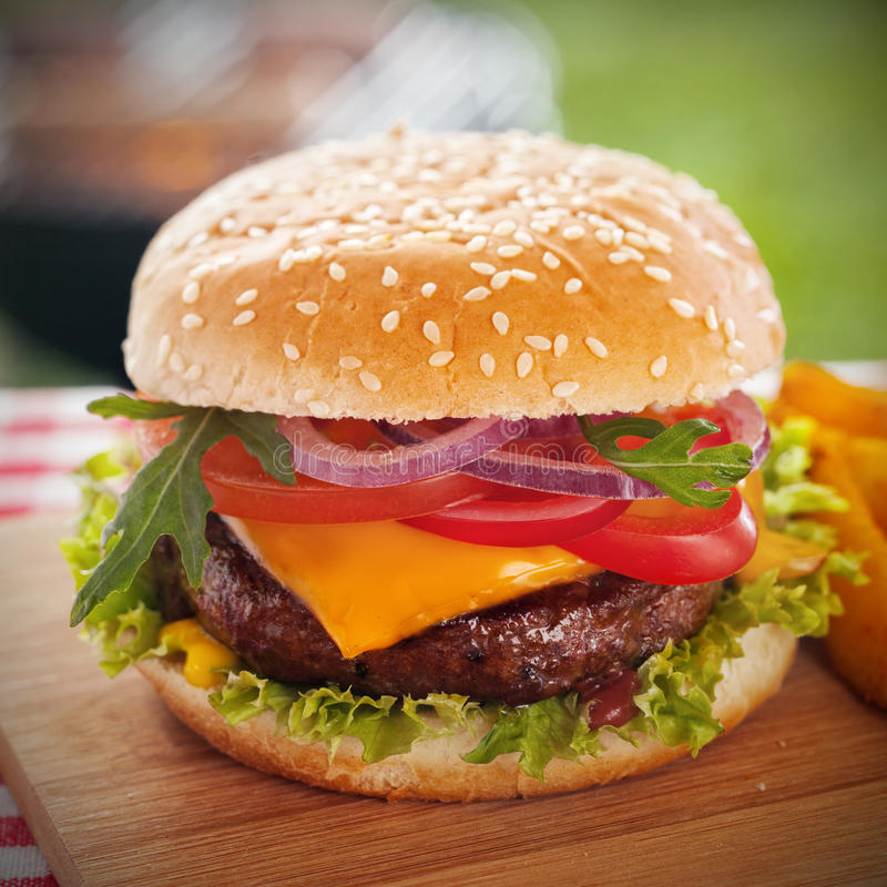 Free Tasty Burger With Melted Cheese On A Sesame Bun Stock Images - 39391814
