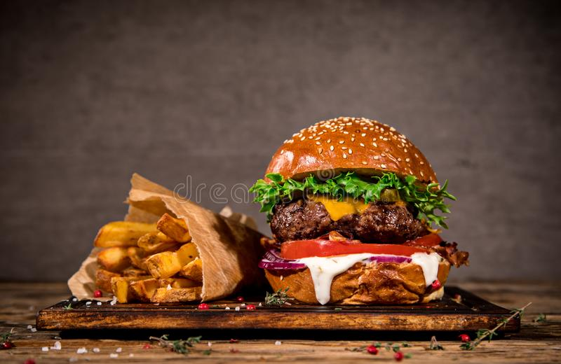 Tasty burger on wooden table. stock image