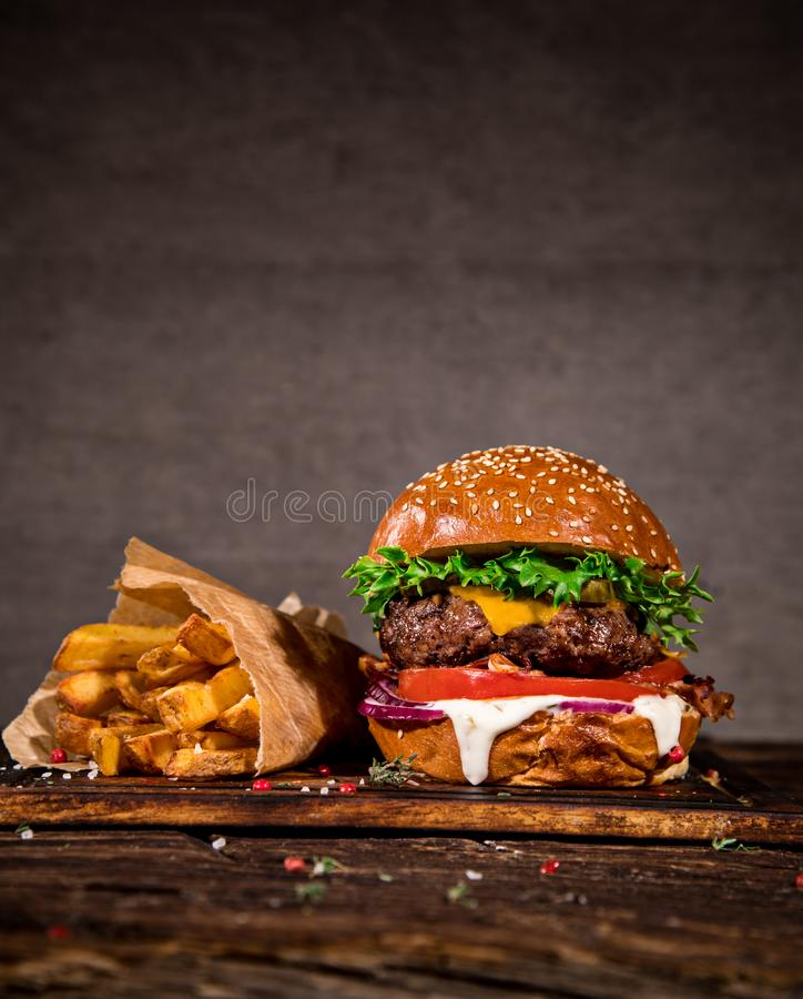 Tasty burger on wooden table. stock images