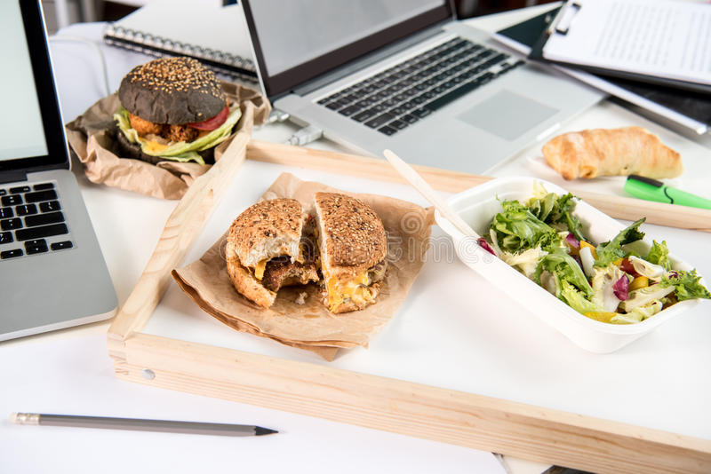 Tasty burgers with fresh salad and bread loaf stock image