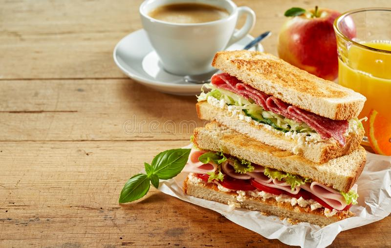 Tasty cafeteria breakfast with sandwiches royalty free stock images