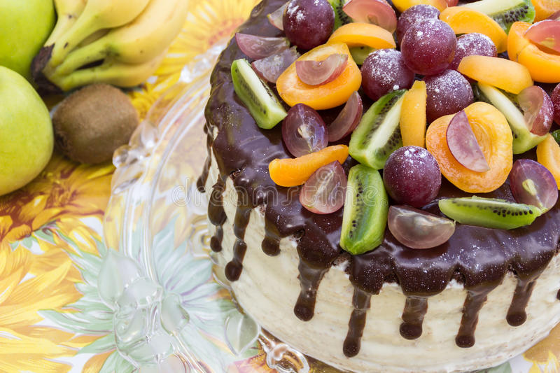 Download Tasty Cake Decorated With Chocolate Glaze And Fruits Half Cake Stock Image - Image: 83724153