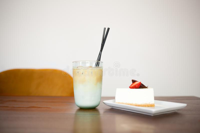 Tasty cake with strowberry and Cold Coffee Frappe. royalty free stock images