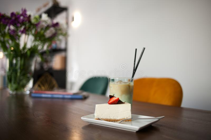 Tasty cake with strowberry and Cold Coffee Frappe. royalty free stock photo