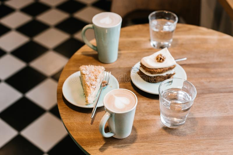 Tasty Cakes, Cupcakes and Cookies with Coffee and Latte in the Luxury Cafe, Coffee Break, Brunch Time, Afternoon Tea royalty free stock image