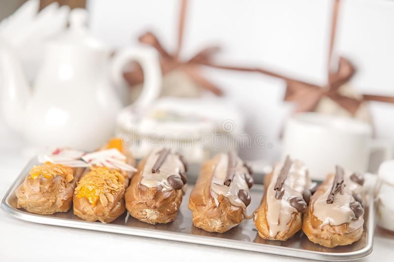Tasty cakes on a tray, restaurant setting. Cream bakery plate pastry delicious food white dessert chocolate closeup slice sweet cafe cheesecake portion calories stock photos