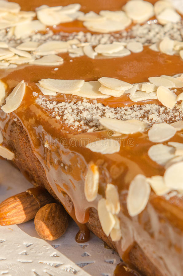Tasty caramel cake with nuts and cinnamon stock image