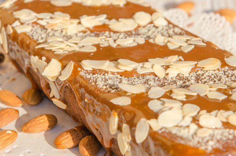 Tasty caramel cake with nuts and cinnamon royalty free stock photography