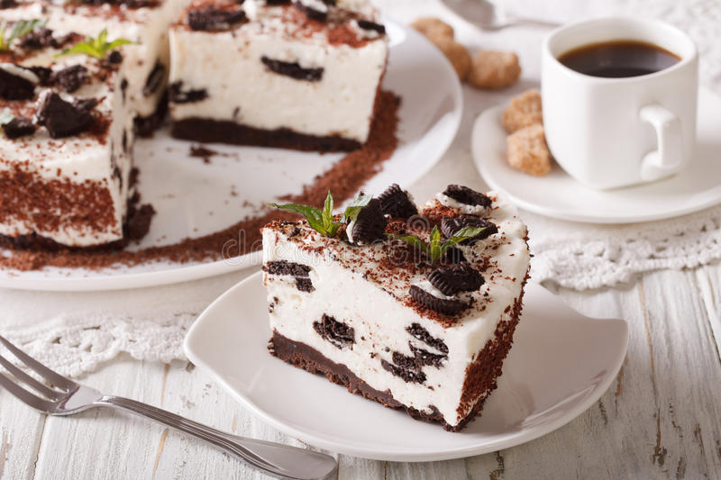 Tasty cheesecake with pieces of chocolate cookies close-up and c royalty free stock photos