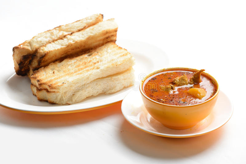 Tasty chicken curry with bread. On the side royalty free stock image