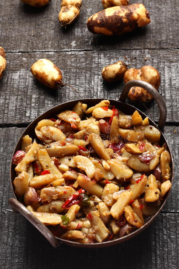 Tasty Chinese potato stir fry. Delicious Chinese potato stir fry in cast iron cookware royalty free stock photography