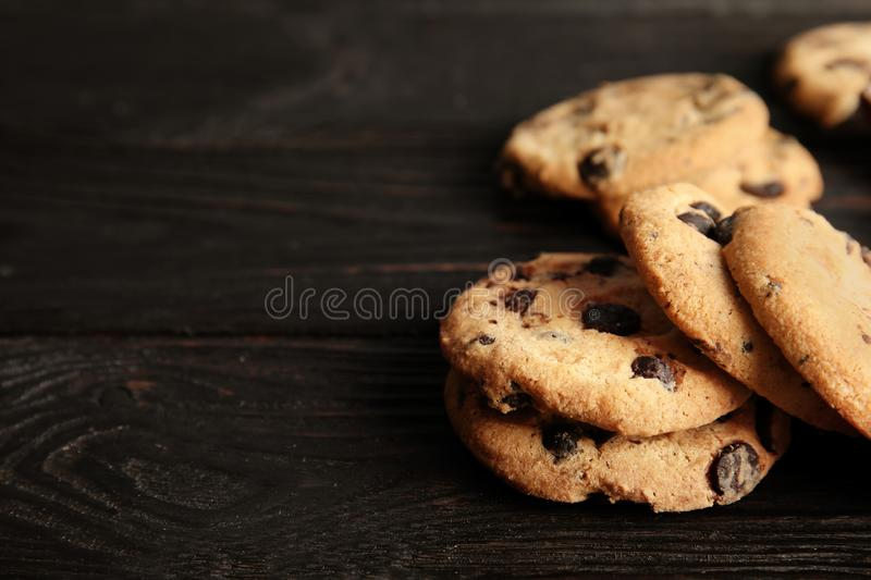 Tasty chocolate chip cookies on wooden table. Space for text stock image