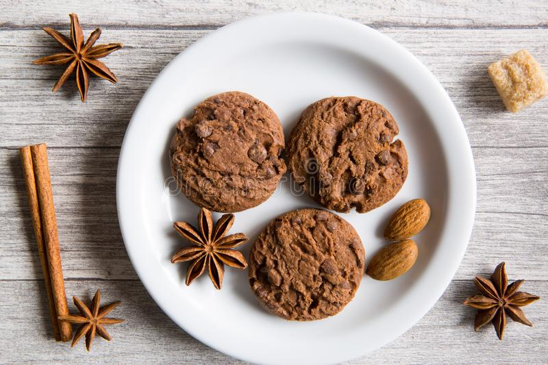 Tasty chocolate cookies, anise stars spices, brown sugar and ci stock image