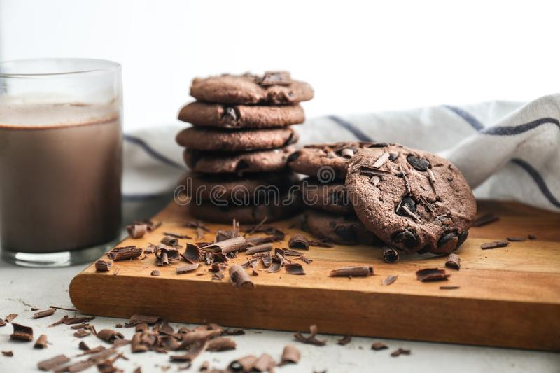 Tasty chocolate cookies with cocoa drink on table royalty free stock images