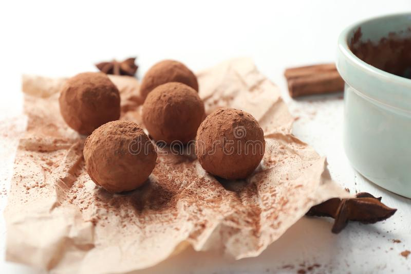 Tasty chocolate truffles on white table, closeup stock images
