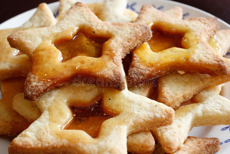 Tasty Christmas star shaped coockies on plate, closeup stock image